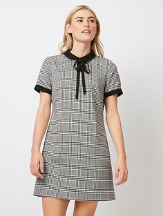 This figure-flattering dress complete with a chic Peter Pan style collar is a throw-on, fuss-free choice for day-to-night dressing. Made from soft fabric wit...