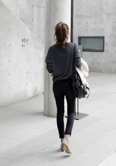 Black jeans and grey long-sleeved sweater.