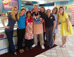 Jo and Mike (center) with other volunteers from the Ice Cream parlor at Give Kids the World