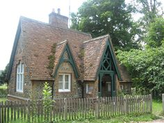 English Cottage, love the steeply pitched roof and the quatrefoil detailing above the entry.