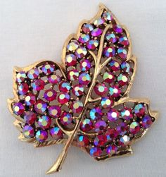 """This has red borealis round cut rhinestones. Brooch is 2 1/2"""" I have been buying and selling this wonderful jewelry for many years and will gladly give you as much honest information as i have or remember about any of my listings just ask."""