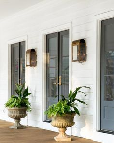 White Exterior Black Doors And Brass Hardware