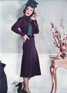 Loretta Young for spring 1938  Loretta in an afternoon frock of wood-violet sheer woolen. The hat is of green suede.