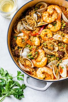 This easy seafood paella, made with shrimp, clams and chorizo is a delicious one-pot weeknight dish! Under 30 minutes too cook! Fish Recipes, Seafood Recipes, Dinner Recipes, Cooking Recipes, Healthy Recipes, Ww Recipes, Bread Recipes, Holiday Recipes, Skinnytaste Recipes