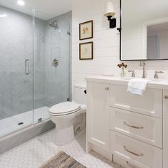 This bathroom remodel now looks fresher, brighter and way more current. Swipe left to see the before. 📷 @amybartlam