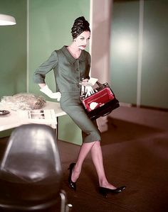 1958 Anne St. Marie with red pencil in her mouth wears a suit by Ben Barrack