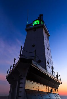 Ludington, Michigan Lighthouse at Twilight on Lake Michigan by Kenneth Keifer
