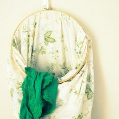 An always-open laundry bag made with inexpensive thrift store items.  It took one minute to make!