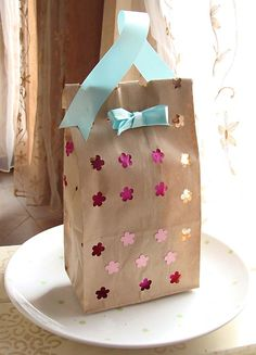 WRAP CREATIVELY  You can reuse gift bags, bows and event paper, but you can also make something unique by using old maps, cloth or even newspaper. Flip a paper grocery bag inside out and give your child stamps or markers to create their own wrapping paper that's environmentally friendly and extra special for the recipient.