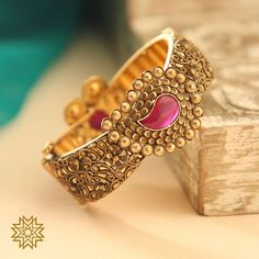 22 carat gold antique bangle with paisley pendant studded with ruby and pearls by Manubhai Jewellers. Plain Gold Bangles, Gold Bangles For Women, Gold Bangles Design, Gold Earrings Designs, Gold Jewellery Design, Gold Jewelry, Jewelry Rings, Manubhai Jewellers, Kundan Bangles