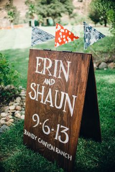 Very Cool Wedding Sign with Flag Banners - Photography: TheHeartsHaven.com - See more of the wedding on SMP, here: http://www.StyleMePretty.com/2014/05/30/diy-summer-ranch-wedding
