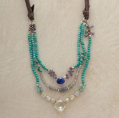 "moody blues necklace  Turquoise frames faceted drops of lapis, labradorite and green amethyst, accented with iolite and chrysoberyl. Soft leather strands lead to a sterling clasp with adjustable links. 17"" to 18""L."