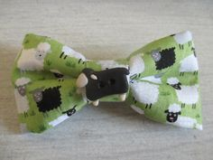 Handy clip-on bow tie  sheep on green grass by TakeABowAmsterdam