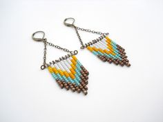 Hand Beaded Chevron Earrings in Bronze, Teal, Mustard Yellow and White. $24.00, via Etsy.
