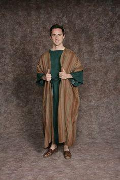 $20.00 Nativity Man #1 teal/black long tunic, brown striped vest, teal/black sash