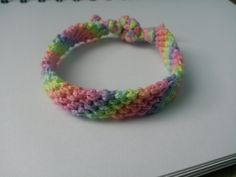I crocheted each colour of the thread and woven it into a candy cane pattern friendship bracelet. The texture of the bracelet looks thicker than the normal thread used.
