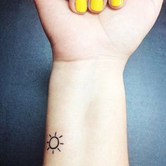small sun tattoo