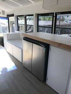 In a school bus conversion, decisions like a under-the-counter refrigerator or a taller one affect the overall design. Function or style? With this refrigerator you can have both.
