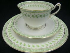 An elegant William Lowe Court China tea trio dating to the Early Edwardian perod Wide rimmed cup with looped handle topped by thumb rest Transfer