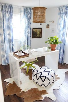 Personality-filled Office with tie-dyed shibori curtains, diy faux marble table and cowhide rug #boho #office