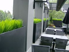 Contemporary Planters outside restaurant