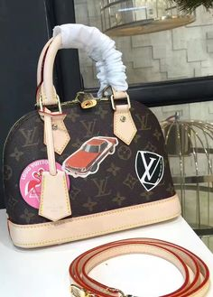 Louis Vuitton Monogram World Tour Alma BB is a pretty bright and practical bag. It features protective studs on the bottom, double zipper closure, and a detachable strap. In addition, it comes with the padlock and leather key tag for a bit of bag charm effect.  See more LV bags at http://www.luxtime.su/louis-vuitton-handbags