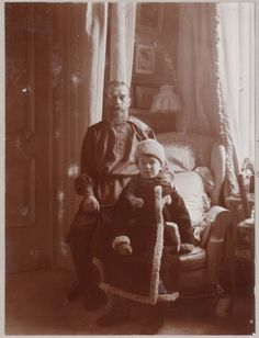 Czar Nicholas and his heir Alexei. The Czar is wearing casual Russian garb.