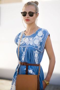 Try the modern boho look. I get a little tired of seeing feather earrings and fringed handbags after Coachella has come and gone. However, an understated modern boho look gets my seal of approval. Channel this look by keeping accessories and embellishments at a minimum. I love this blue and white embroidered dress with camel accessories and gold jewelry, captured by Vanessa Jackman.