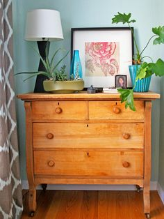 A vintage dresser adds warmth and a rustic quality to the bedroom. Mary Jo tops the furniture with pretty plants and black and turquoise accessories.