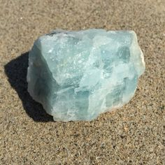 Feast your eyes on this large natural baby blue Aquamarine crystal to channel your inner mermaid and water goddess! This soothing crystal is unheated and untreated. It also has inclusions of black tourmaline for added grounding benefits.  The natural light blue color of this Aquamarine crystal evokes cooling and calming energies.  Work with Aquamarine to improve communication issues, to speak from the heart and for throat chakra work.