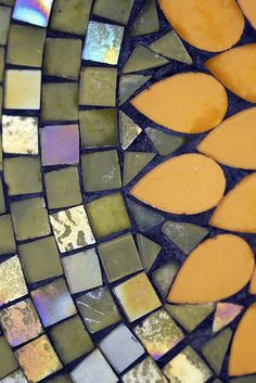 Mosaic tiles- I want to make a table with a similar design one day!