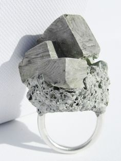 Concrete Objective Ring - Faceted angles have been cast and shaped by hand into a sculptural, cubist-style grey ring. Care instructions: Thi...