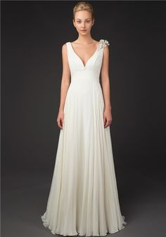 Silk chiffon gown with v neck, ruched waistline and flower appliqué detail on shoulder