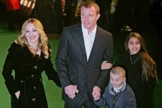 London, UNITED KINGDOM:  (FromLtoR) US Pop Star Madonna, her husband and British Film Director Guy Ritchie and children, Rocco and Lourdes arrive at the British Premiere of animated film 'Arhur and the Invisibles', 25 January 2007, in London. Madonna's provides the voiceover for one of the film's characters. Actors Harvey Keitel and Robert De Niro also appear in the film. AFP PHOTO / CARL DE SOUZA  (Photo credit should read CARL DE SOUZA/AFP/Getty Images) via @AOL_Lifestyle Read more…