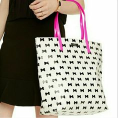 *Flash Sale* Kate Spade Daycation Bon Shopper Large bag with black bow pattern. Super cute design and the material is easily wipeable in case anything spills on it! Hot pink handles. Two pockets on the inside. Brand new! Not even out of the wrapping yet but I can unwrap it to take more pics if you're interested. Just let me know! kate spade Bags Totes
