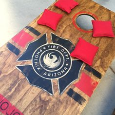 Custom fire department, firehouse cornhole boards. Can be customized with department maltese, name and badge number. www.porchprincess.com Fire Dept, Fire Department, Fireman Crafts, Firefighter Room, Cornhole Designs, Fundraising Events, Fundraising Ideas, Custom Paint Jobs, Cornhole Boards