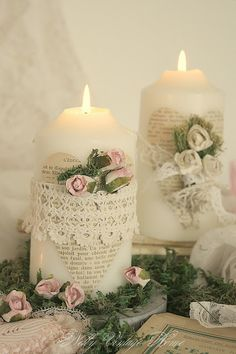 candles adorned with book page hearts, vintage lace, and pink and white roses