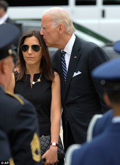 Joe Biden's son Beau's casket arrives to lie in honor at Delaware state Capitol . The Vice President is seen here comforting his daughter in law Hallie.