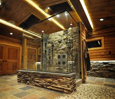 WOW...unbelievable shower and bathroom!  Skylights, accent lighting under the ceiling beams and lots of stone.  Gorgeous!