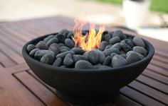 DIY: Tabletop Fire Bowl Enjoy the outdoors despite the temperature drop. This tabletop fire bowl is the perfect way to stay toasty and warm while enjoying the crisp outdoor air. Fire Pit Bowl, Fire Bowls, Diy Fire Pit, Indoor Fire Pit, Tabletop Fire Bowl, Fire Table, Outdoor Fire Pit Table, Tabletop Fireplaces, Diy Fireplace