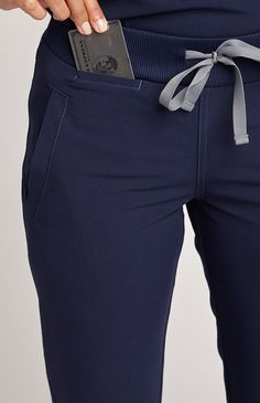 Moca Scrub Jogger in Navy - Technically speaking, she's a must-have. Athletic in look and function our Moca technical jogger is bursting with street-style and features contoured leg seams, four functional pockets, athletic ribbed ankle cuffs and stylish contrast top-stitching.