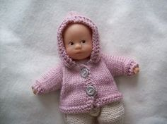 This is a one-piece little coat for a Mini-Corolle : a French baby doll of 20cm (8inches). You'll only have to sew body sides and sleeves.