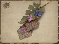 Woodland pendant with leaves and butterflies  by TheArkanaWorkshop