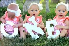 baby's first birthday #photoideas {We tried this - but we used paper cut-outs of the letters. NOT smart! She immediately tore them up! } #tinytotties