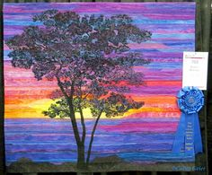 My quilt Sunset Sentinel with it's ribbon from the AQS Show in Albuquerque. I'm sooo happy! (Strip pieced landscape quilt with confetti tree.)