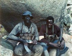 Black and white sodiers (with black camo on face and hands) of rhodesian SAS with small weapons from communist countries : and RPK. Military Special Forces, Military Love, Military Photos, Military Gear, Military History, Military Weapons, War Photography, War Machine, South Africa