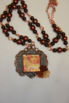 copper colored frame glass square picture by hudathotjewelry, $20.00