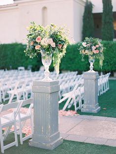 outdoor wedding ceremony flower arrangements on pedestals