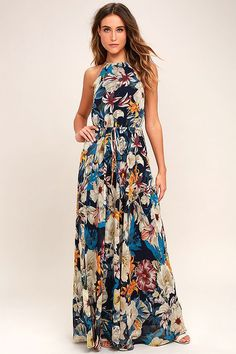 Lulus Exclusive! Add a touch of style to your day in the park with the Gazebo Spirit Navy Blue Floral Print Maxi Dress! Shades of navy blue, purple, teal, and taupe decorate woven poly as it falls from a drawstring halter neckline with back keyhole. Drawstring waistline flows into a full maxi skirt. Beaded ties.