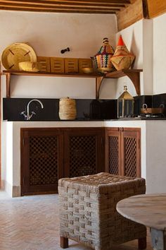The Arabic interiors are known for their colourful, tiled interiors. Kitchen Counter Stools, Bar Stools, Kitchen Cabinets, Step Inside, Moroccan, Entryway Tables, Kitchen Decor, Latest Trends, Interior Design